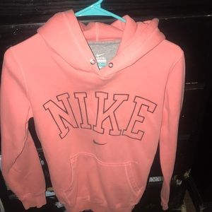 Coral pink nike sweater with a hoodie